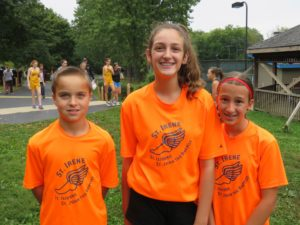 Three St. Isidore students participated in CC this past fall: (l-r) Ben Conte - 5th grade (ran 1 mile race). Amelia Arms - 8th grade (ran 2 mile race), and Alyssa Falco - 6th grade (ran 1-1/2 mile race).