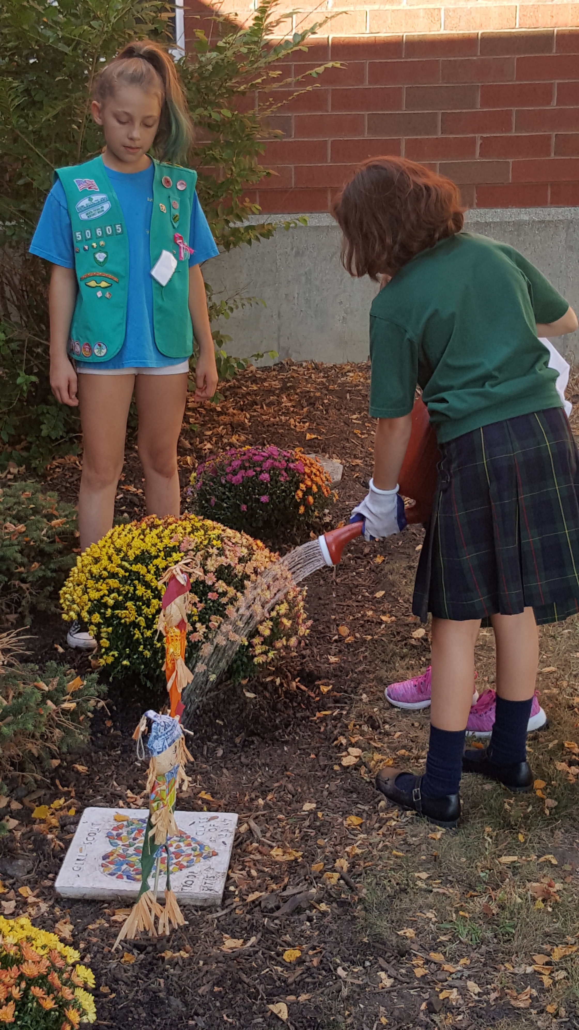 5th Grade Girl Scouts Help Beautify the Garden