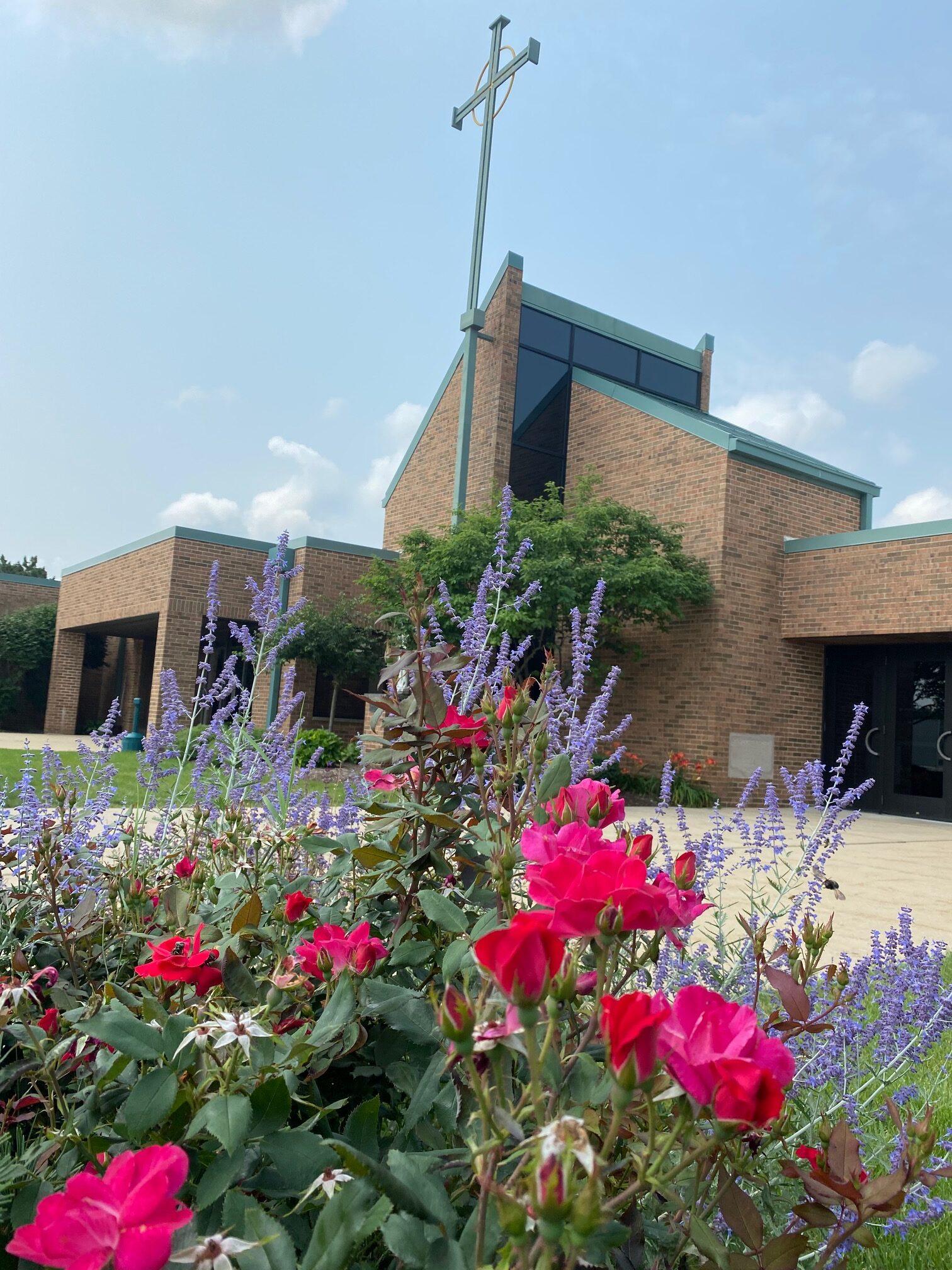 church cross behind flowers 7-2021